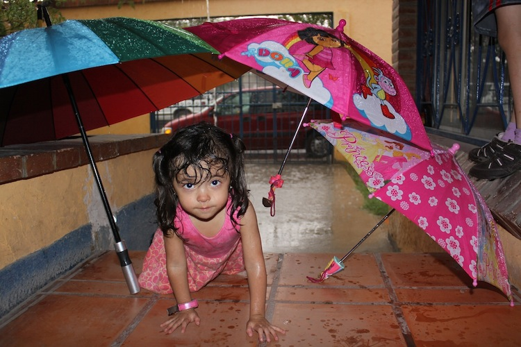 Dalia playing in the rain on the porch of the house in 2010. Photo: © Itzel Aguilera.