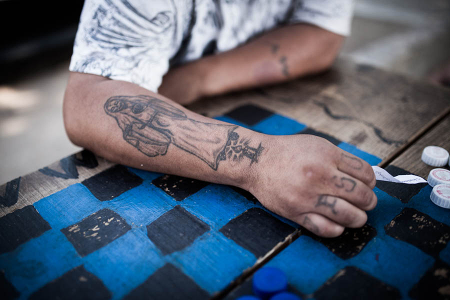 "A migrant shows his tattoo that reads ""Jesus"": his son's name, and the most important person in his life."